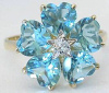6.5 ctw Blue Topaz Flower Ring with diamond accent in 14k