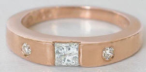 0.44 carat Princess and Round Cut Diamond Ring in 14k rose gold
