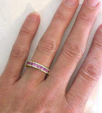 Channel Set Princess Cut Pink Sapphire Annviersary Band in 14k yellow gold