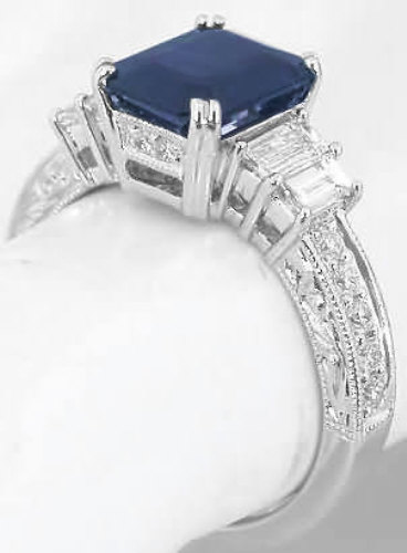 Emerald Cut Sapphire and Baguette and Round Diamond Ring in 18k