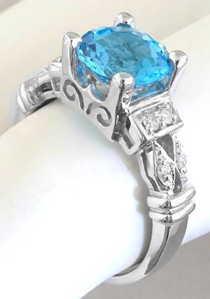 8mm Round Swiss Blue Topaz And Diamond Engagement Ring In