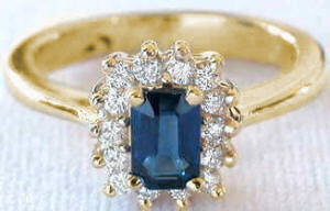 Emerald Cut Sapphire and Diamond Halo Ring in 14k yellow gold