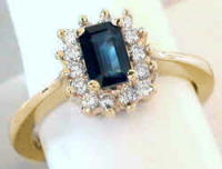 Emerald Cut Sapphire Diamond Halo Ring in 14k yellow gold