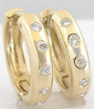 0.15 ctw Burnished Diamond Huggie Earrings in 14k yellow gold. High polish finish.