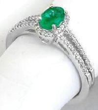 Split Shank Oval Emerald and Diamond Ring in 14k white gold