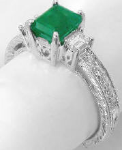Emerald Cut Emerald and Baguette Diamond Ring in 14k white gold