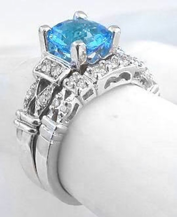 Round Swiss Blue Topaz Engagement Ring In 14k White Gold