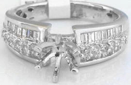 0.72 ctw Round and Baguette Diamond Engagement Ring in 14k white gold