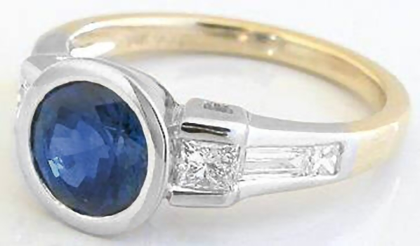 Bezel Set Round Sapphire And Tapered Baguette And Princess