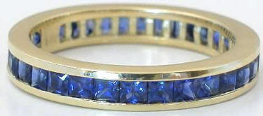 Channel Set 3 ctw Princess Cut Sapphire Eternity Band in Yellow Gold