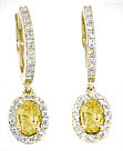Oval Yellow Sapphire and Diamond Halo Earrings in 14k yellow gold