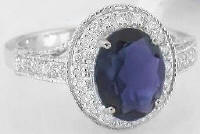 iolite and diamond halo engagement rings