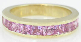 princess cut pink sapphire wedding band in yellow gold