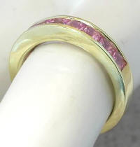 Channel Set Princess Cut Pink Sapphire Band in 14k yellow gold