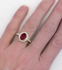 Oval Ruby with  Diamond Halo in 14k yellow gold