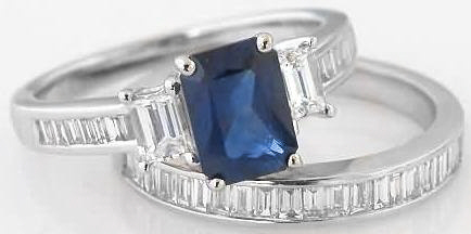 emerald cut sapphire and baguette engagement ring
