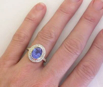 bezel set oval tanzanite and diamond halo ring in 14k white gold gr 7044. Black Bedroom Furniture Sets. Home Design Ideas
