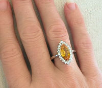 Fine Jewelry: Marquise Cut Natural Yellow-Orange Sapphire and Diamond Halo Ring