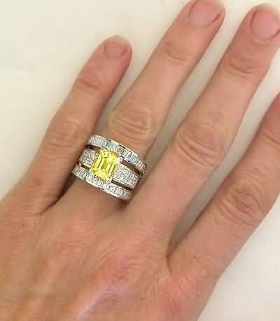 emerald cut yellow sapphire and baguette and invisibly set